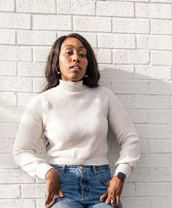 Jordan taylor photography, black woman in cream sweater and jeans, zara white boots, lace up white boots, zara lace up boots, new look blue jeans